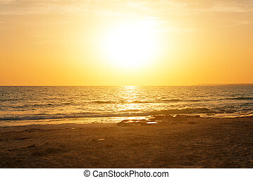 Sunset over the sea. Photograph from the beach.