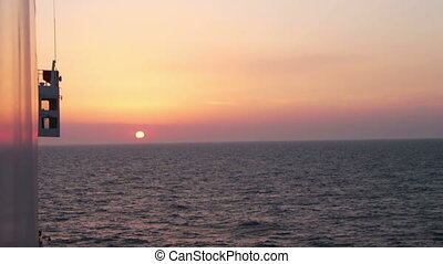 Sunset over the Sea View from the Ferry. Deck of the ship...