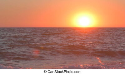 Sunset over the sea water with ligh