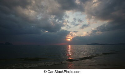 sunset over the sea with clouds