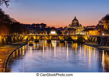 Sunset over the St. Peters Basilica and the river Tiber in ...