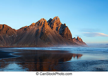 Sunset over the Stokksnes Mountain on Vestrahorn Cape in Iceland