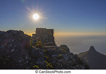 Sunset over the Table Mountain cable car station with Lion's...