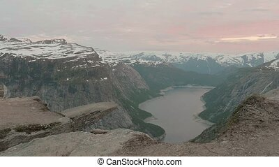Sunset over the Trolltunga. Norway, smooth dolly shot
