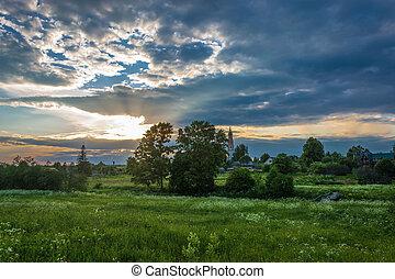 Sunset over the village of Mikhailovskoye, Ivanovo region,...