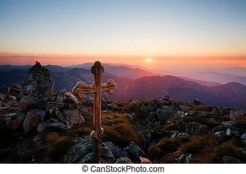 sunset over the wooden cross