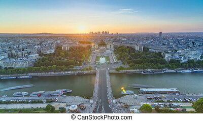 Sunset over Trocadero timelapse with the Palais de Chaillot seen from the Eiffel Tower in Paris, France.