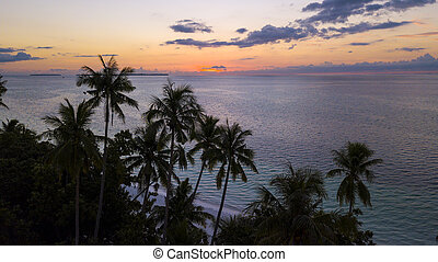Sunset over tropical beach - Aerial shot of sunset over the ...