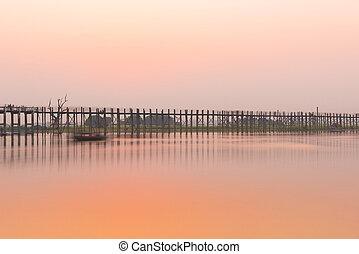 U Bein Bridge - Sunset over U Bein Bridge over Taungthaman...