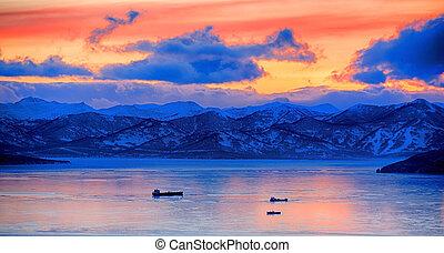 Sunset over vespers Petropavlovsk-Kamchatsky on the background of the Avachinsky bay