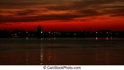 Sunset over Volga-river In Astrakhan with beautiful red sky,...