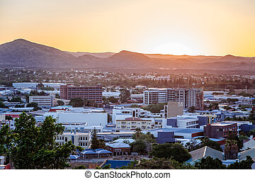 Sunset over Windhoek central business district and mountains in