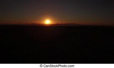 Sunset over windmills