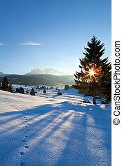 sunset over winter alpine meadows