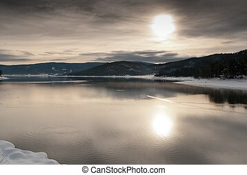 Sunset over winter lake