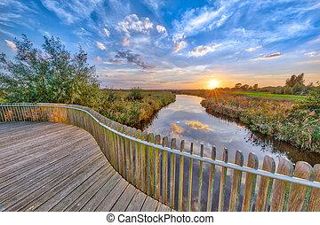 Sunset over Wooden Balustrade on bridge