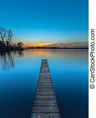 Sunset over Wooden Jetty in Groningen, Netherlands