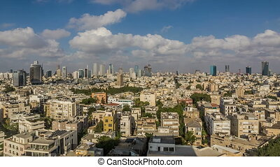 Sunset panorama of Tel Aviv over the roofs to the office...