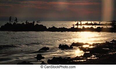 Sunset people bathe, in the sea beach swim boats, waves...