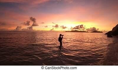 sunset photographer at Seychelles - Woman photographer with...