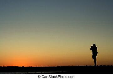 Sunset Photographer - Photographer capturing the sunset