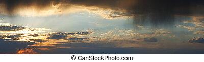 Sunset rainy cloudy sky panorama