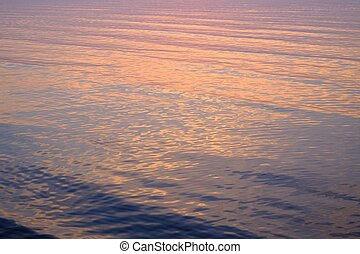 Sunset reflection in a calm sea water
