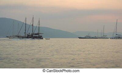 Sunset Regatta of Sailing boats in the Boka bay, Montenegro, Adriatic, in 4k