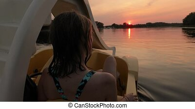 Sunset ride on a lake in a pedal boat - Lake sunset, young ...