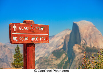 SUNSET road sign of Glacier Point