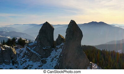 Sunset rocky summit, flying drone. Lady's Stones in Rarau...