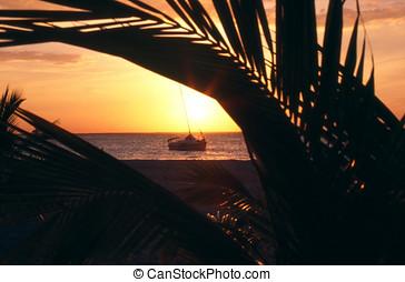 Sunset Sailboat 1 - Sailboat at sunset on Isla Mujeres,...