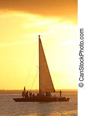 Sunset Sailing - Sailing ship at sunset off Isla Mujeres,...