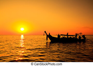 Sunset sea and boat Koh Phi Phi thailand