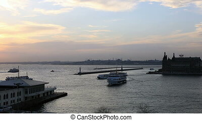 sunset sea traffic - kadikoy and haydarpasha dock at...