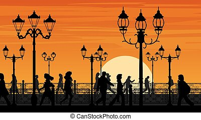 Sunset seafront street with people.