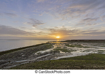Sunset seascape of Olhao salt marsh Inlet waterfront to Ria...