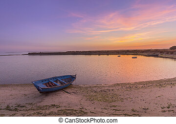 Sunset seascape view of Olhao salt marsh Inlet, waterfront...