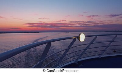 Sunset seen from deck of cruise ship.