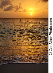 Tropical sunset on the Caribbean island of Grand Cayman at Seven Mile Beach