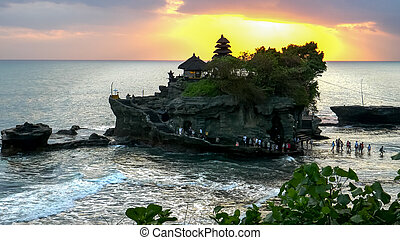 sunset shot tanah lot temple at high tide on bali