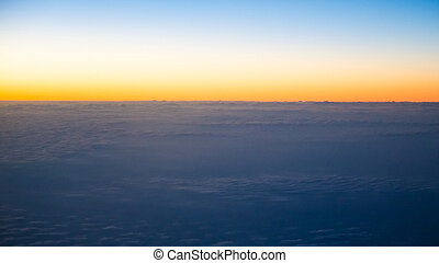 Sunset sky and cloud view from airplane