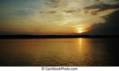 Sunset sky and clouds on the volga river