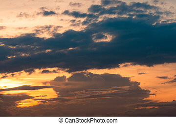 Sunset sky. Heaven sky. Orange sky with soft white fluffy cloud. Sunlight at dusk. Beauty in nature. Beautiful natural pattern layer of clouds in the evening. Dusk and dawn times abstract background.