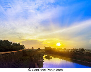 Sunset sky of multiple colors scaterred ray of