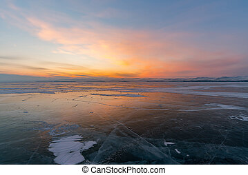 Sunset sky over frozen water lake, Baikal Russia