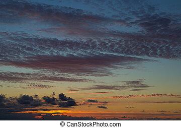 sunset sky - darkening sunset sky with many types of clouds,...