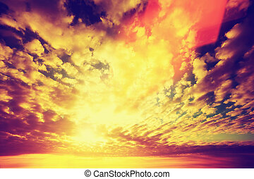 Sunset sky, sun shining through clouds. Vintage style, ...