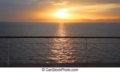sunset sky, view from deck of moving cruiser