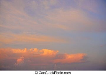 Sunset sky with orange golden clouds